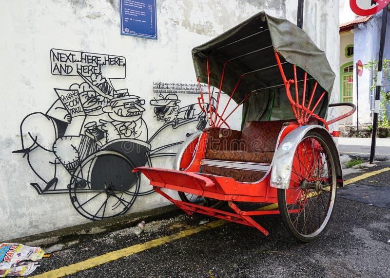 Un stationnement de tricycle sur la rue à Penang, Malaisie images libres de droits