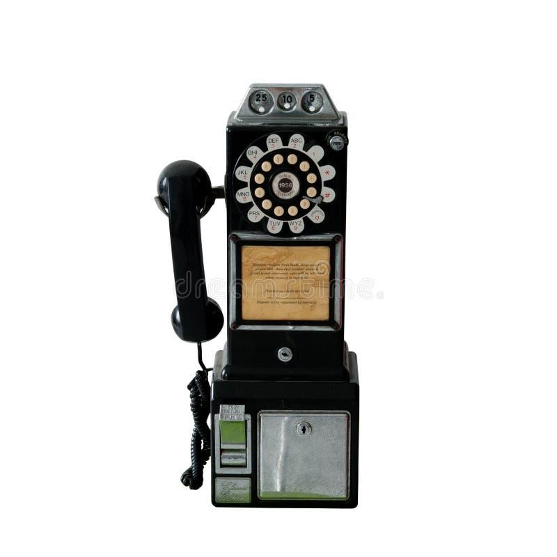 Un téléphone de salaire public de vieux cru d'isolement sur le blanc photographie stock libre de droits