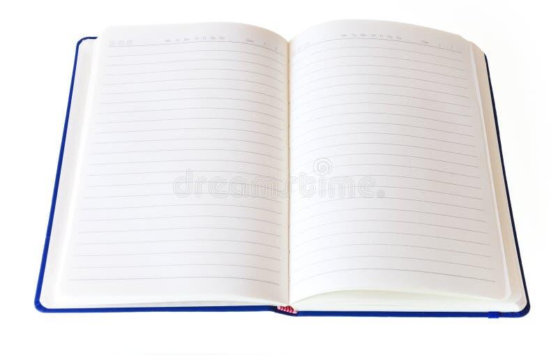 Un taccuino aperto isolato su un fondo bianco immagini stock libere da diritti