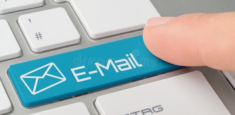 Un teclado con un botón etiquetado azul - email imagen de archivo