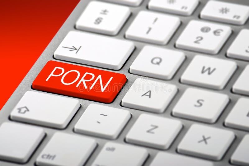 Un teclado con una llave de la pornografía imágenes de archivo libres de regalías