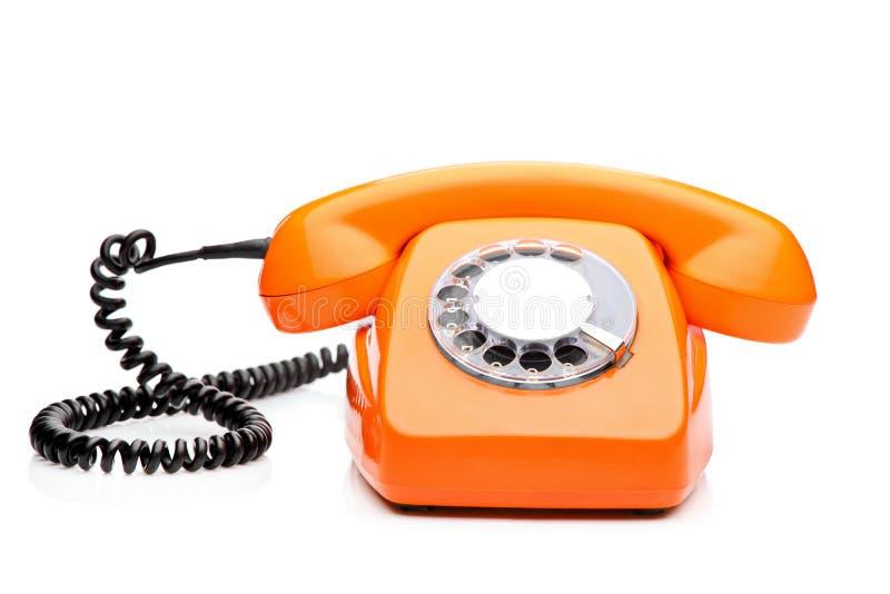 Un teléfono anaranjado retro fotos de archivo libres de regalías