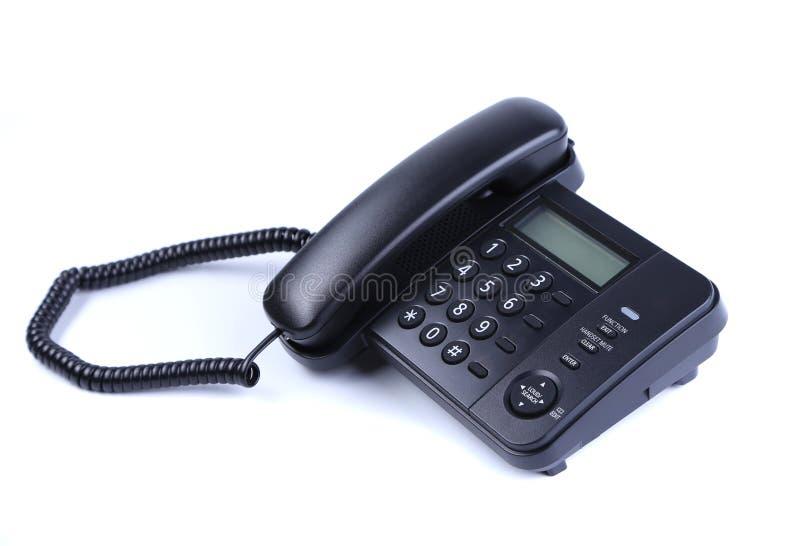 Un teléfono de la línea horizonte en el fondo blanco foto de archivo libre de regalías