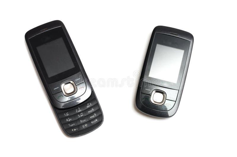 Un teléfono móvil interrumpido de la diapositiva 2G en posiciones cerradas y abiertas de la llamada fotografía de archivo