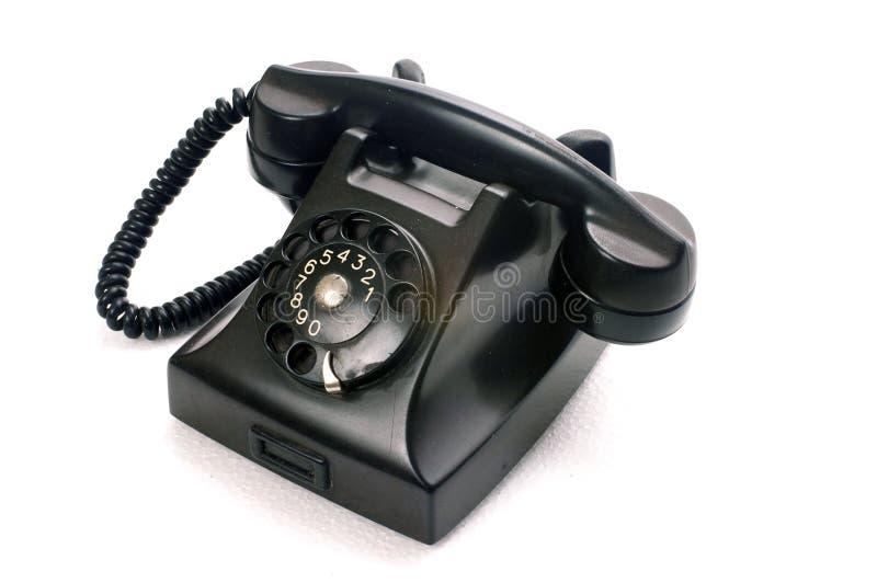 Un teléfono negro fotos de archivo