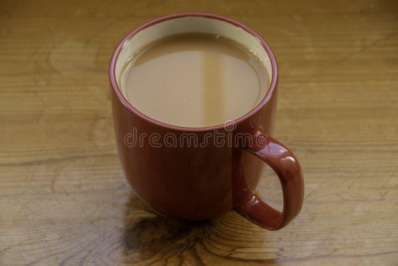 Un thé rouge de tasse de thé image stock