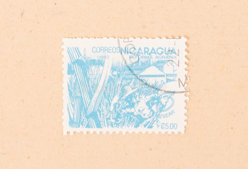 Un timbre imprimé au Nicaragua montre les réformes agraires, vers 1983 image stock