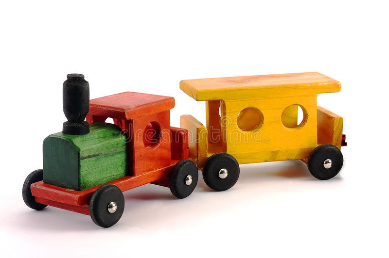 Un treno di legno luminoso del giocattolo isolato fotografia stock libera da diritti