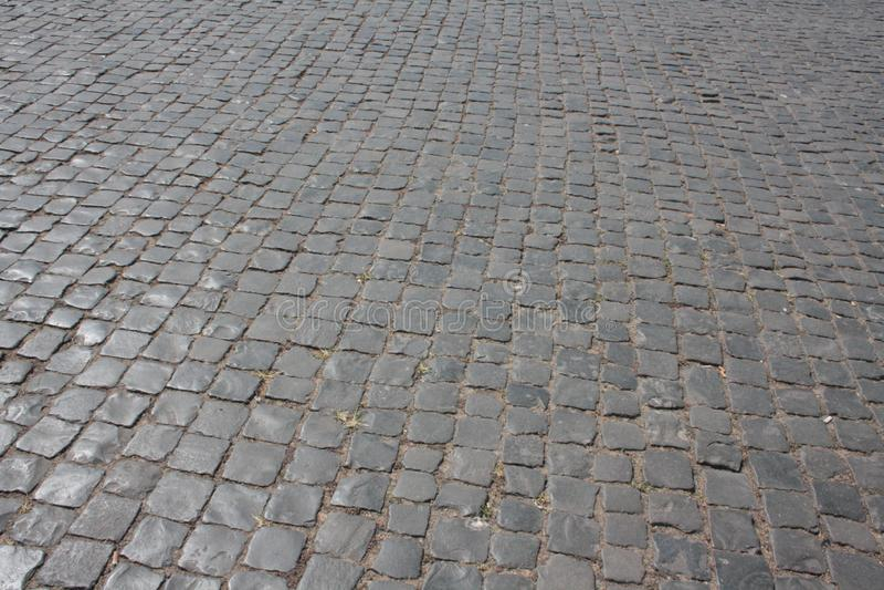 Un trottoir italien typique : Sampietrini ou Sanpietrini Rebecca 36 photographie stock libre de droits