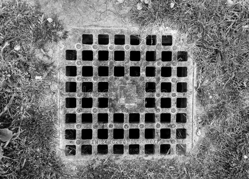 Un trou d'homme sur le plancher photographie stock