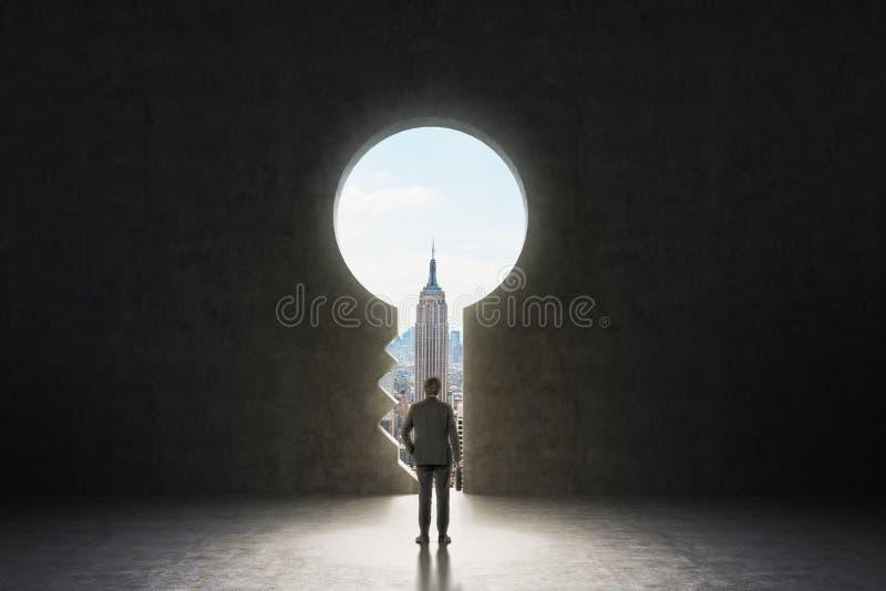Un trou de la serrure dans le mur en béton photos stock