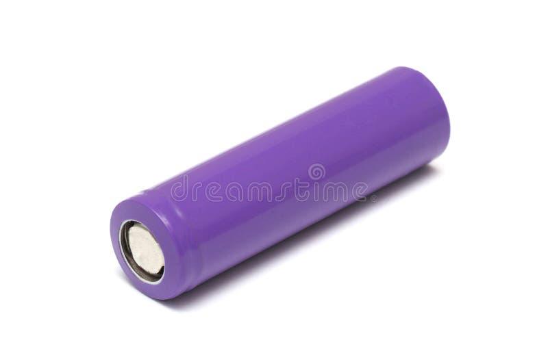 Un'unità ricaricabile cilindrica dell'Accumulatore litio-ione colorata porpora fotografie stock libere da diritti