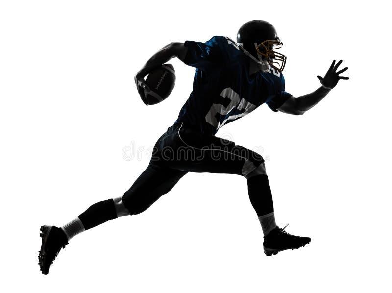 siluetta corrente dell'uomo del giocatore di football americano fotografie stock