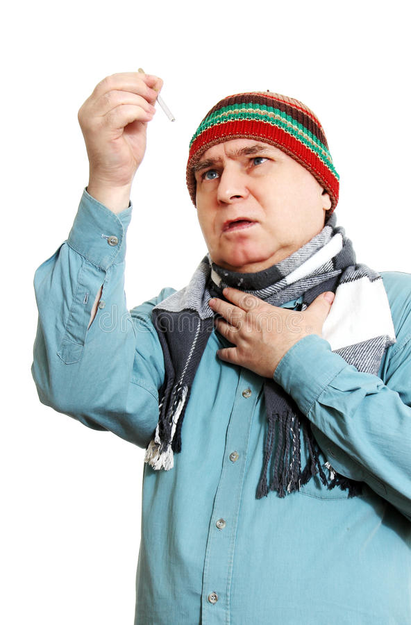 Un uomo con un contagoccia della medicina. fotografie stock libere da diritti