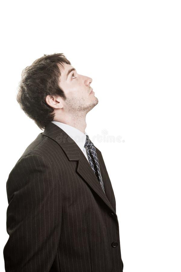 Un uomo d'affari in attesa che osserva in su fotografie stock libere da diritti