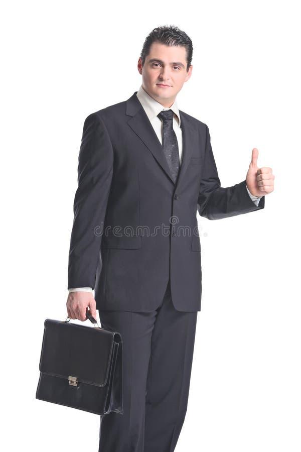 Un uomo d'affari con i pollici in su fotografia stock libera da diritti