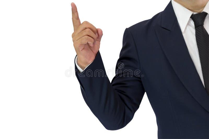 Un uomo d'affari sta vestito elegante in un vestito ed in un dito blu immagini stock