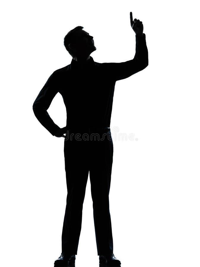 Un uomo di affari che poiting sulla siluetta felice immagini stock libere da diritti