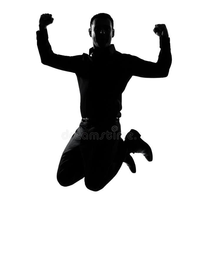 Un uomo di affari che salta siluetta potente fotografia stock