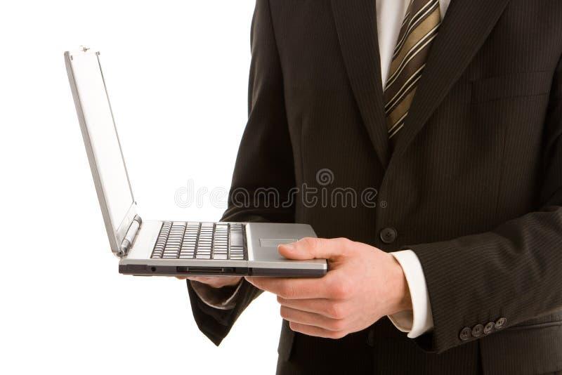 Download Un Uomo Di Affari Che Tiene Un Computer Portatile D'argento Immagine Stock - Immagine di internet, corporativo: 7315859