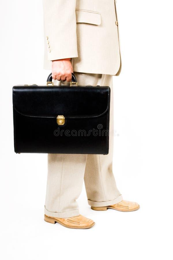 Un uomo di affari in un vestito fotografia stock libera da diritti