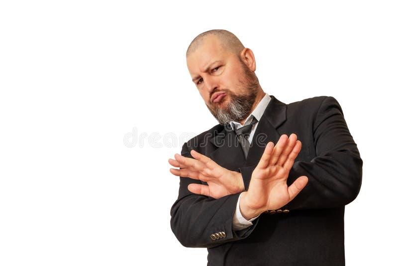 Un uomo dimostra emozionalmente il rifiuto e lo mostra con la sua h immagine stock