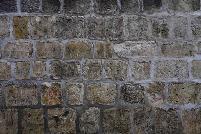Un vecchio muro di mattoni fotografia stock