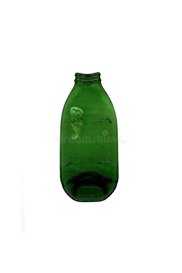 Un verde ha premuto la bottiglia di vetro fatta di riscaldando nel forno fotografia stock libera da diritti