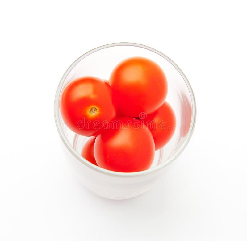 Un vetro dei pomodori di ciliegia immagini stock