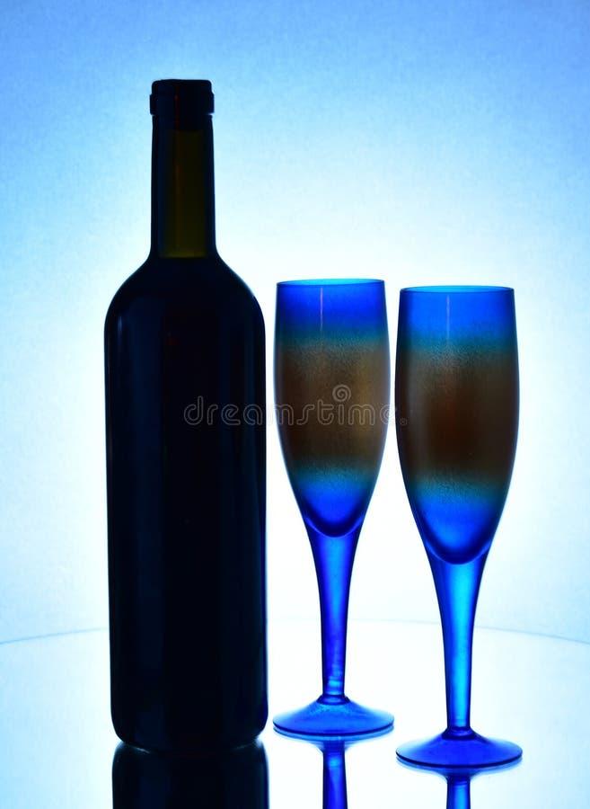 Un vidrio de la botella de vino fotografía de archivo libre de regalías