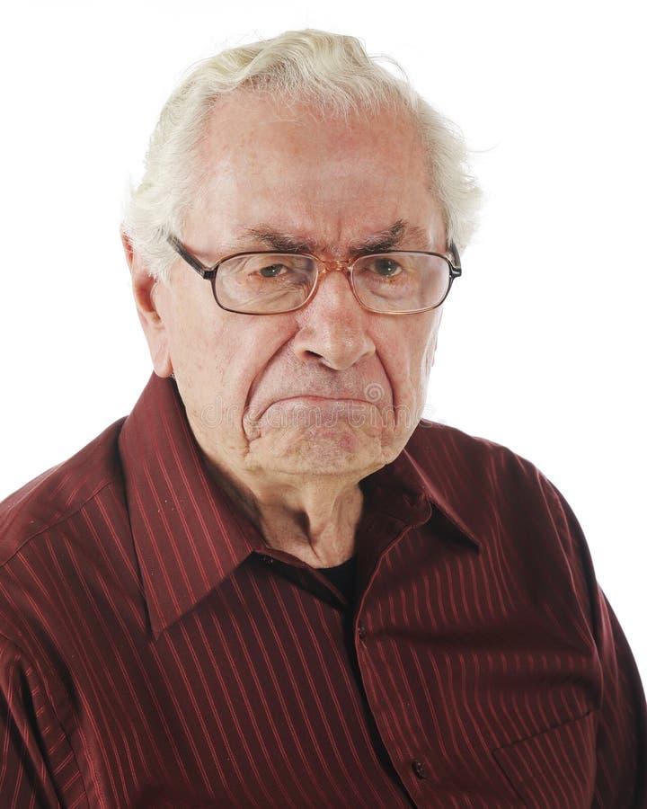 Un viejo hombre gruñón imagenes de archivo