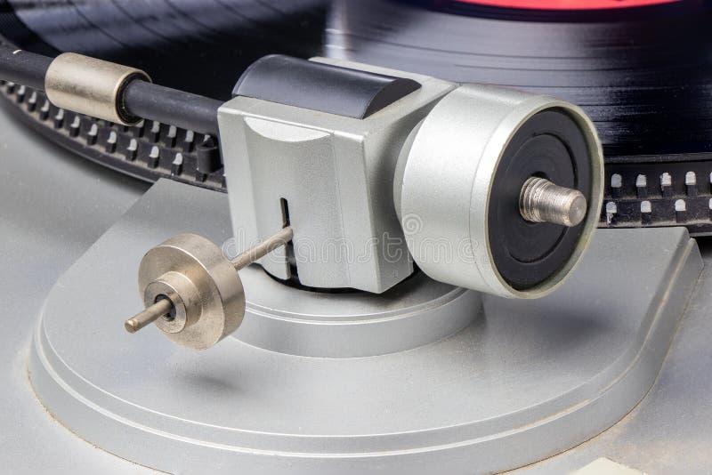 Un viejo jugador de la tableta con un disco imagenes de archivo
