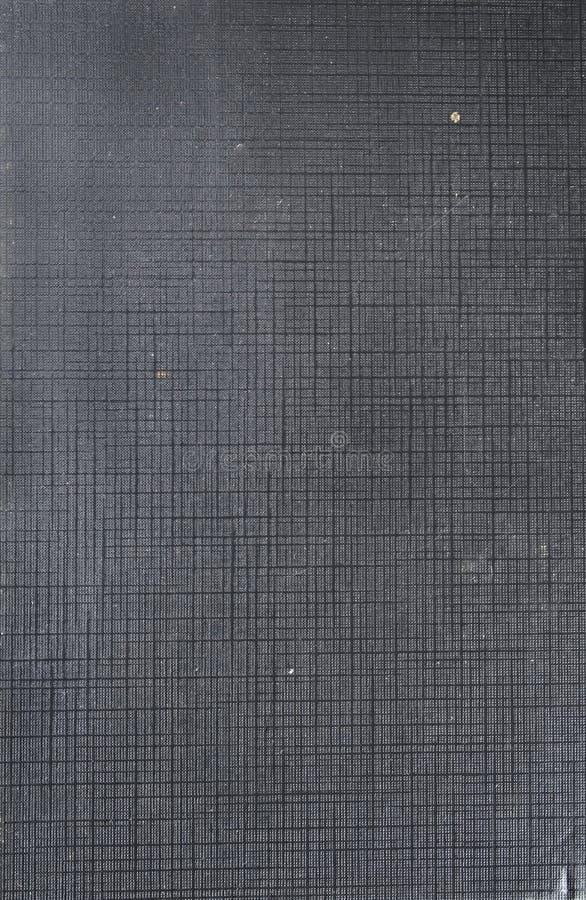 Un vieux cache de livre de tissu photographie stock libre de droits