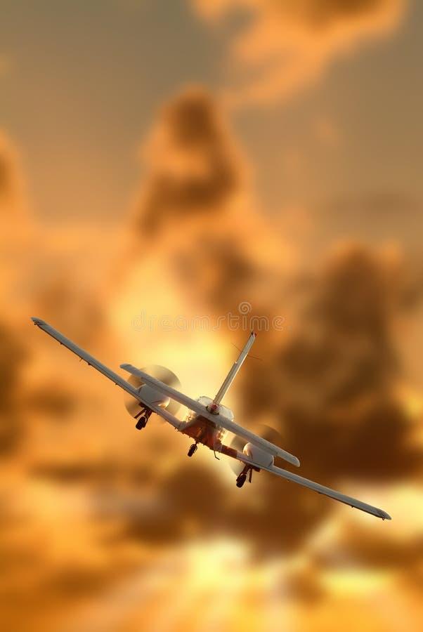 Un volo gemellare dell'aeroplano del motore fotografia stock libera da diritti