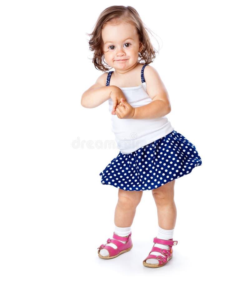 Una bambina sta proponendo fotografia stock