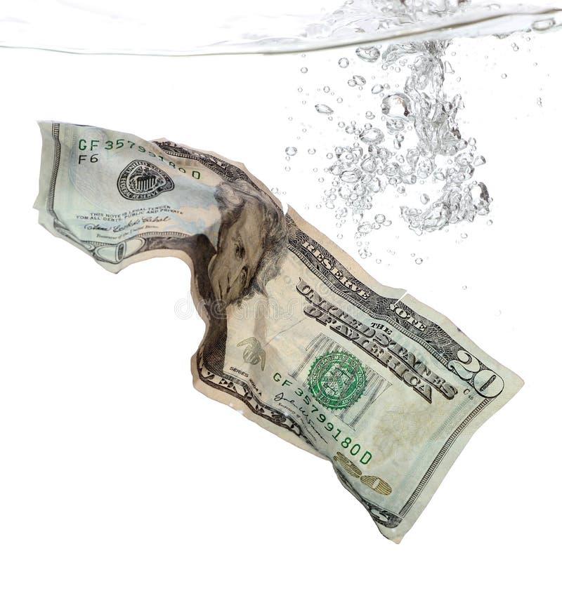 Una banconota dei 20 dollari in acqua fotografia stock