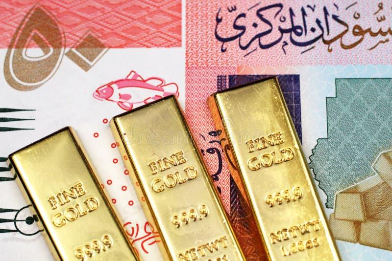 Una banconota sudanese da cinquanta libbre con tre barre di oro fotografie stock libere da diritti
