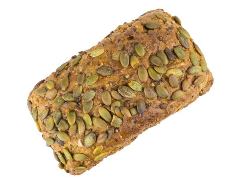 Una barra de pan de la harina de trigo con las semillas del girasol, de la calabaza, de la alcaravea, del cereal y de sésamo Aisl imagenes de archivo