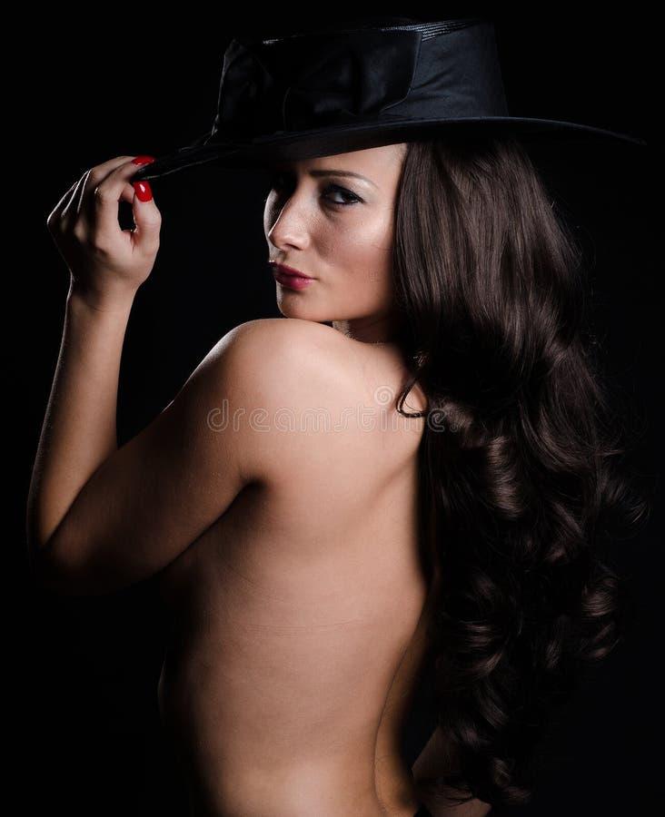 Bella, donna alla moda in cappello fotografia stock