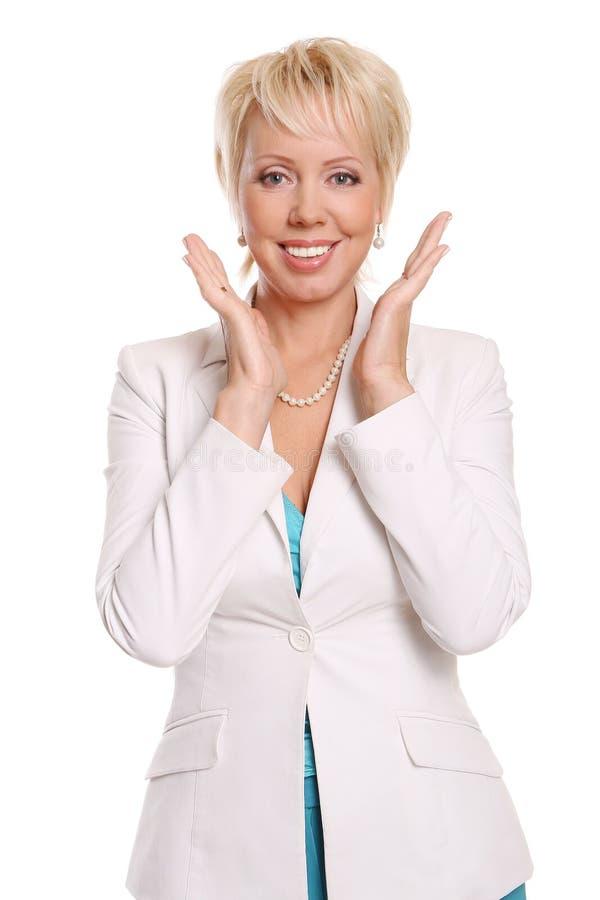 Una bella donna attraente su bianco immagini stock