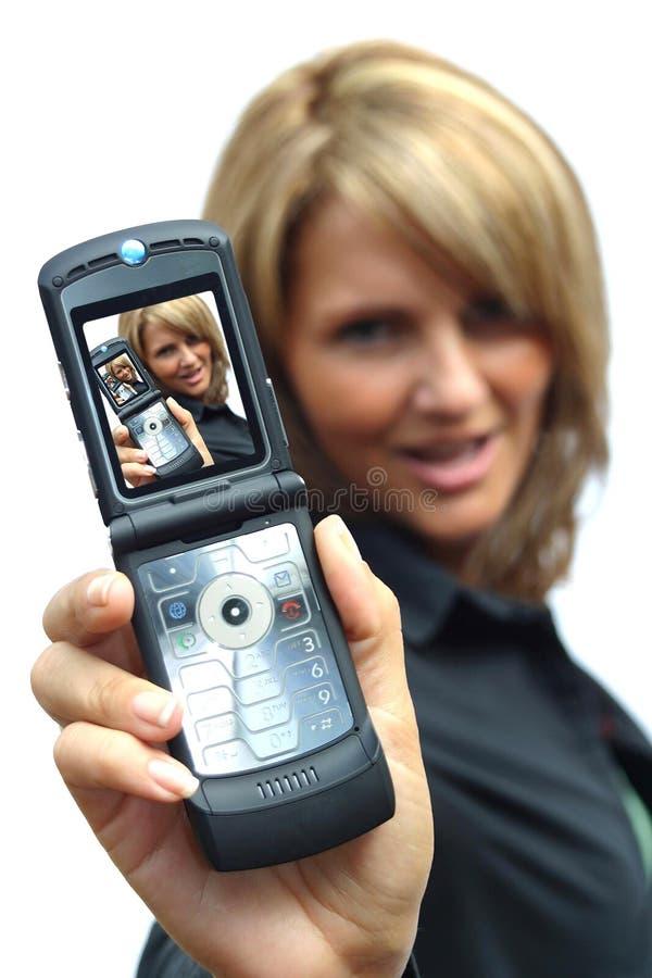 Una bella donna con il telefono fotografia stock