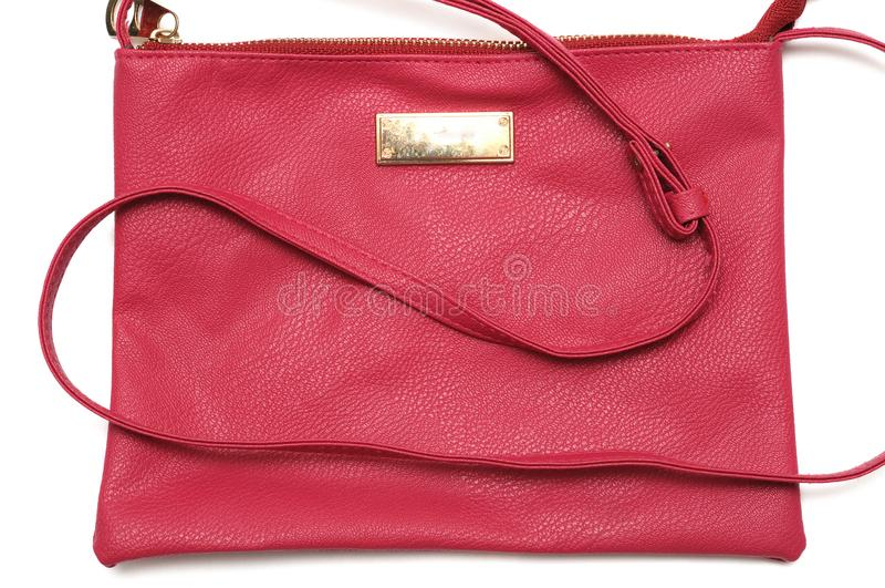 Una borsa dell'imbracatura del ` s delle donne di rossi carmini fotografia stock