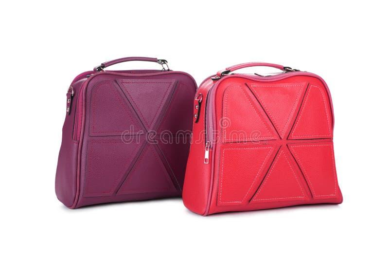 Una borsa di due donne eleganti sopra fondo bianco immagine stock