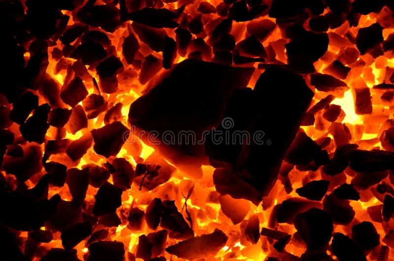 Una bruciatura consistente di contrapposizione luminosa del fondo irrita di antracite delle frazioni differenti fotografie stock