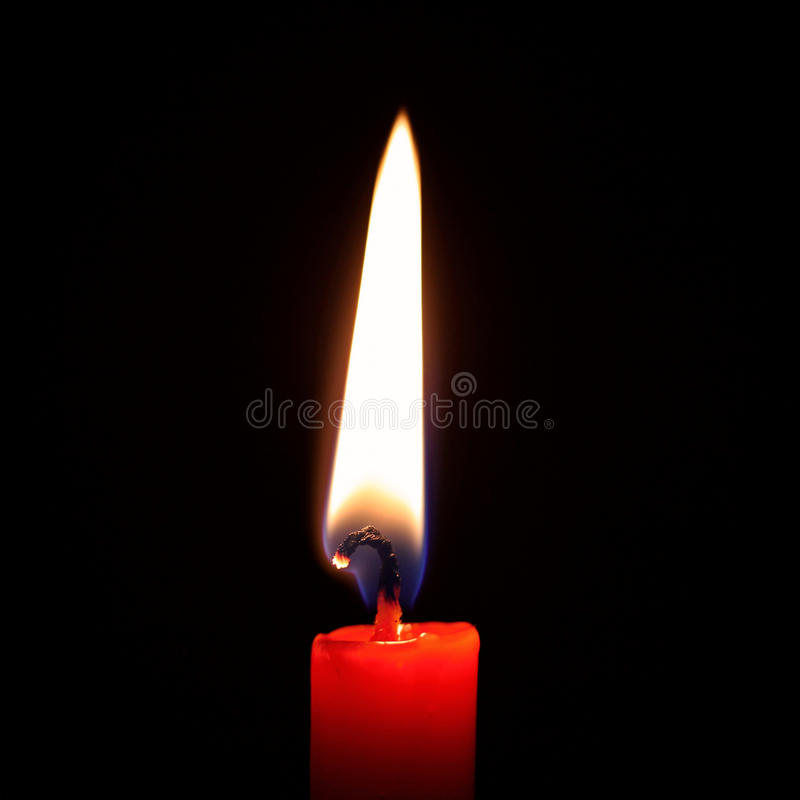 Una candela bruciante fotografie stock libere da diritti