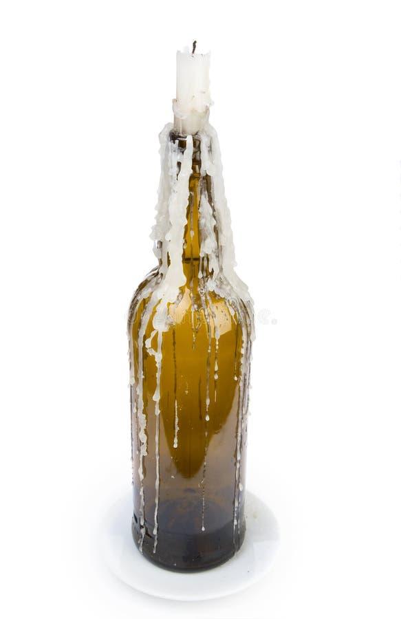 Una candela ha attaccato in una bottiglia fotografie stock
