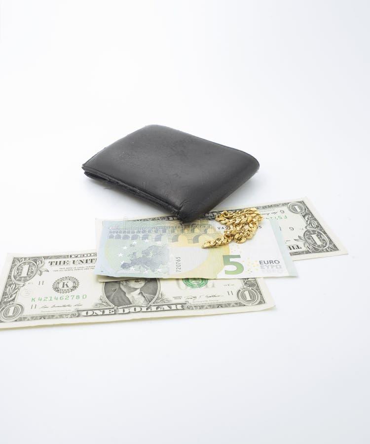 Una cartera con la pulsera de los billetes y del oro fotos de archivo libres de regalías