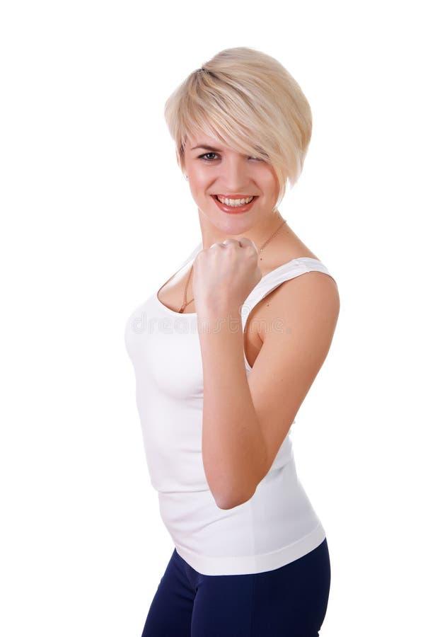 Una chica joven encantadora en un blanco fotografía de archivo