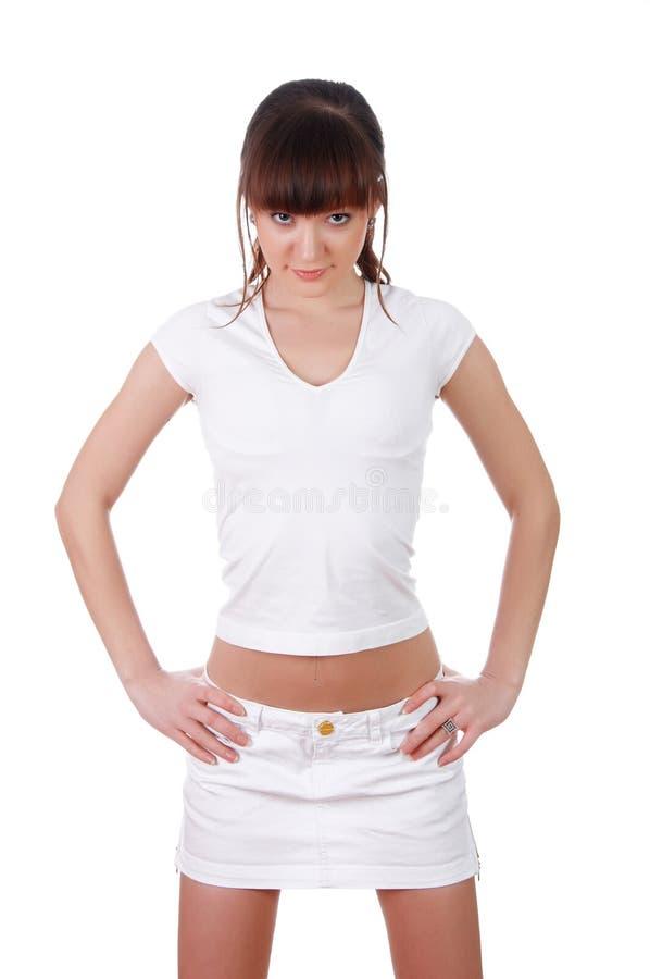Una chica joven encantadora en un blanco imagenes de archivo