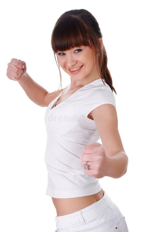 Una chica joven encantadora en un blanco imagen de archivo